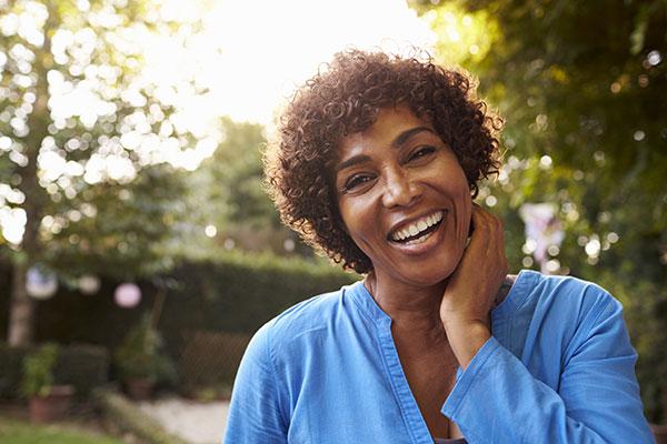 mature woman outside smiling
